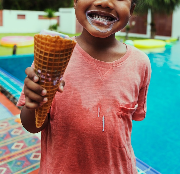 Closeup of african descent girl with ice cream by the pool