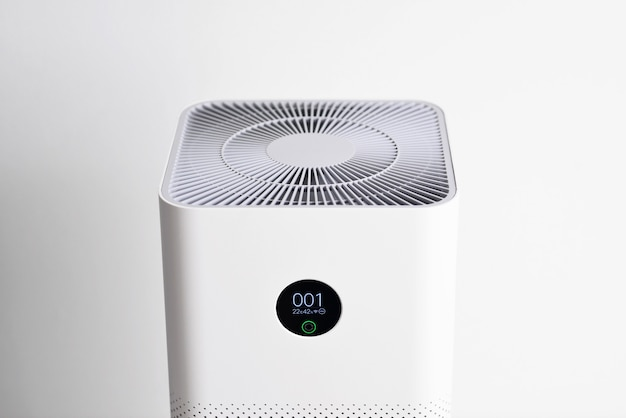 Closeup of air purifier with monitor screen show air quality in the room pm25 concept air purifier system cleaning dust pm 25 pollution in living room