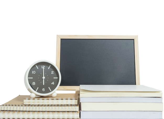 Closeup alarm clock for decorate show 6 o'clock on pile of book with wood blackboard