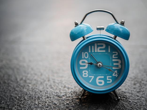 Closeup alarm clock  with black background.
