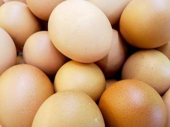 Closeup and crop of heap brown chicken eggs.