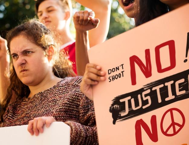 Closeup of angry teen girl protesting