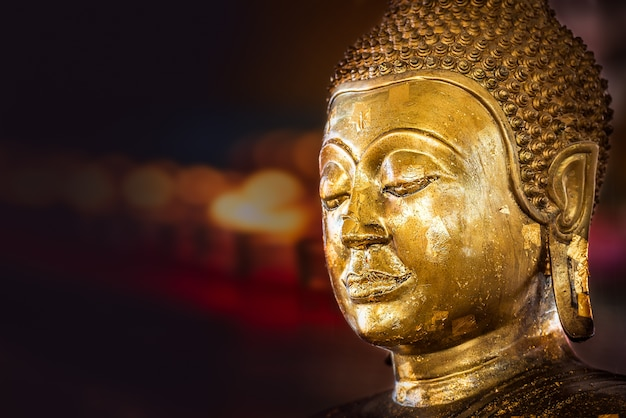 Closeup of the antique buddha bronze statue with gold foil