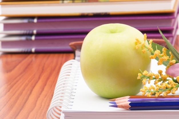 Closeup apple fruit with education supply on table