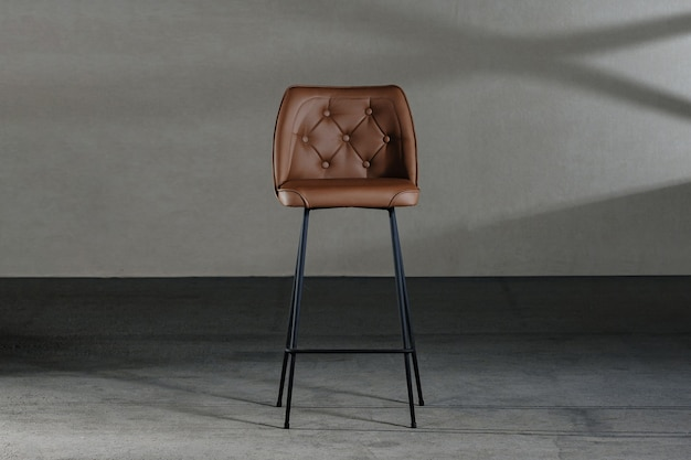 Closeup of an armless chair with a concave back, loft-style furniture