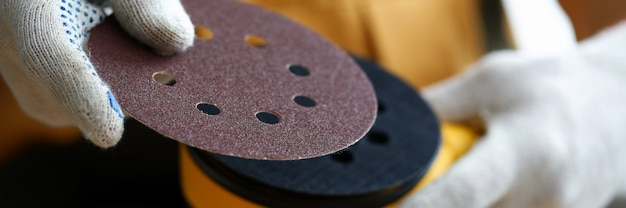 Closeup arms replacement sole for sander machine. preliminary cleaning and polishing surfaces. tool for finishing in country house. grinding equipment for domestic and professional use