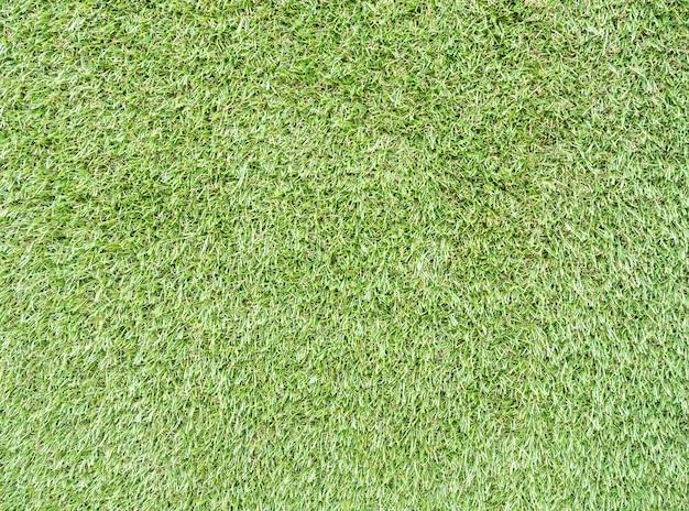 Closeup of the artificial grass background.