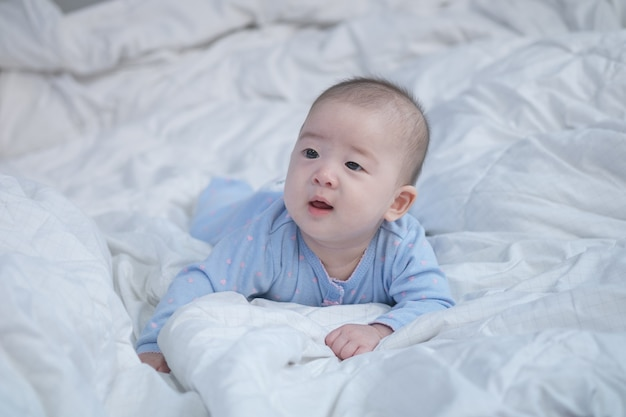 Closeup asian baby boy on bed