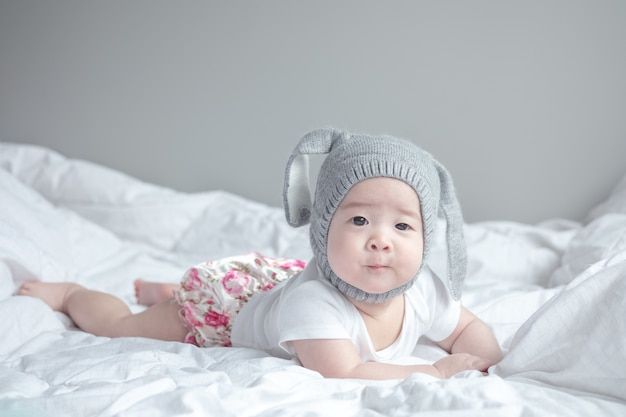 Closeup asian baby boy in cute motion Premium Photo