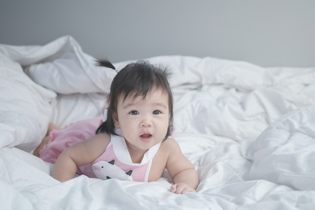 Closeup asian baby girl on bed
