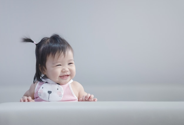 Closeup asian baby girl in cute motion