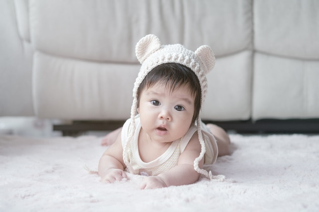 Closeup asian baby girl lie on carpet in cute motion
