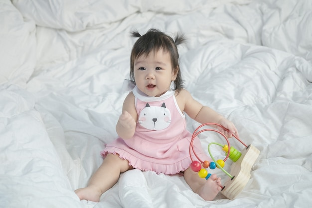 Closeup asian baby girl with a toy