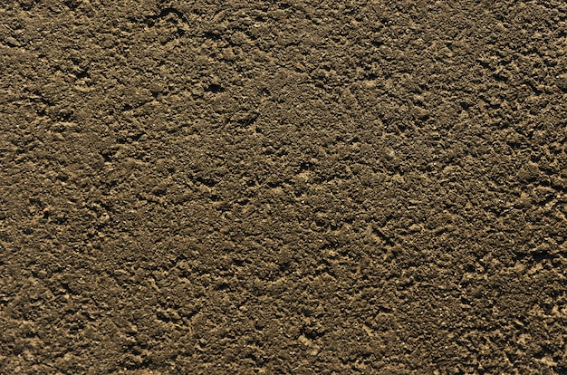Closeup of an asphalt road textured gray background