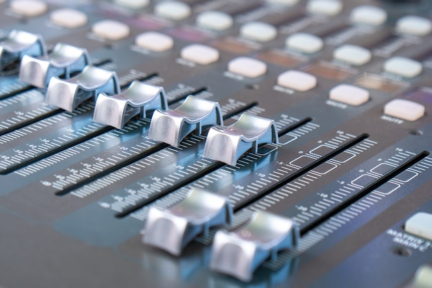 Closeup of an audio mixer, sound acoustic musical mixing, music