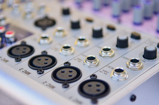 Closeup audio mixer, volume controller amplifier background in the studio.