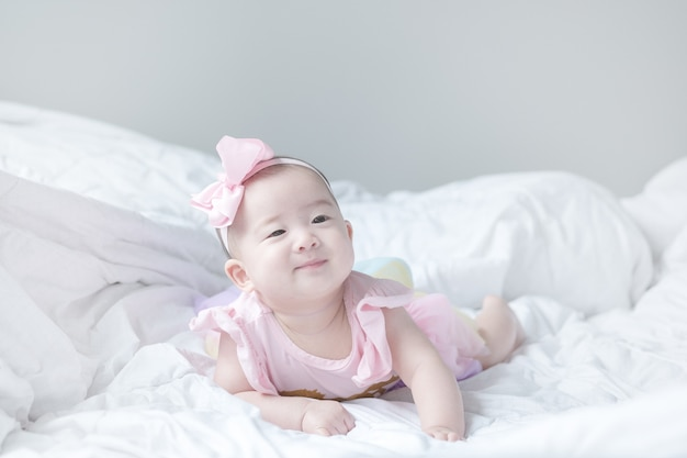 Closeup baby girl in cute motion on bed Premium Photo