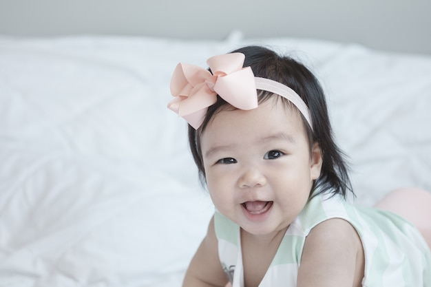 Closeup baby girl in cute motion with copy space
