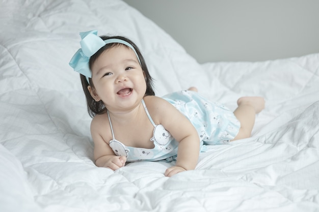 Closeup baby girl in funny motion with copy space Premium Photo