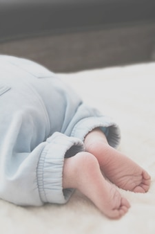 Closeup of baby's feet on a white blanket