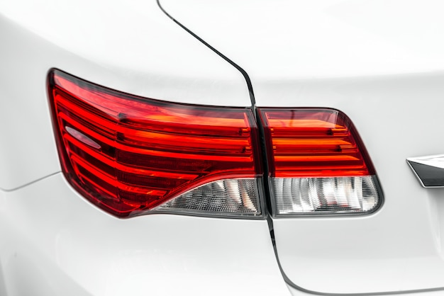 Closeup back lamp of a white luxury car