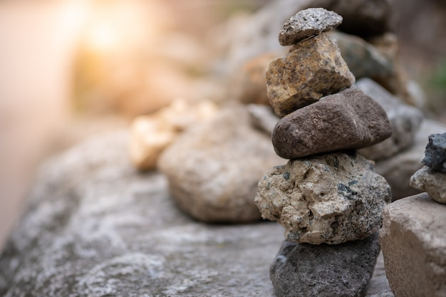 Closeup of balancing rock stack pyramid for mediation and harmony concept.