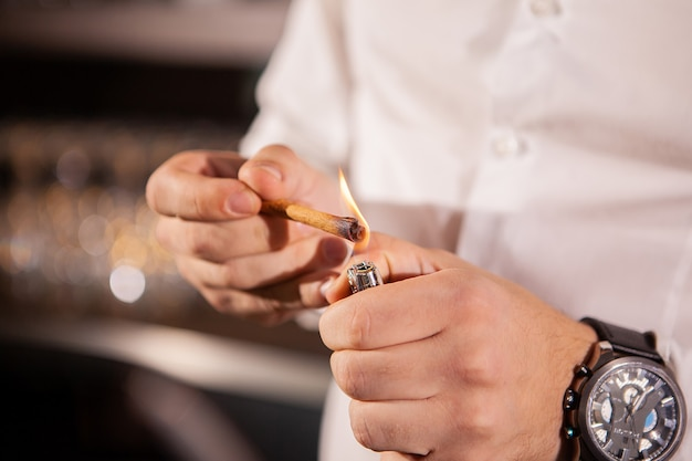 Closeup of bartender hands pouring alcoholic drink.professional drink making