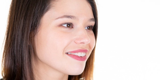 Closeup beautiful brunette girl smile portrait  and side copyspace