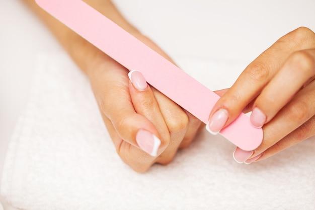 Closeup of beautiful female hand applying hand cream.