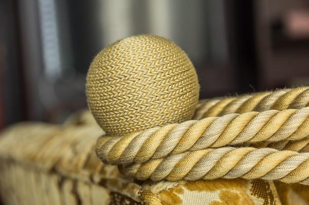 Closeup beautiful golden rope made of silk