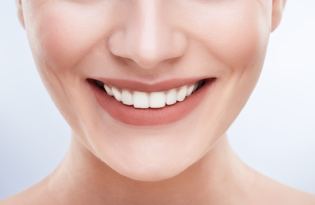 Closeup of beautiful snow-white smile. ideal strong white teeth, teethcare. healthcare, stomatological concept for dentists. only smile Premium Photo