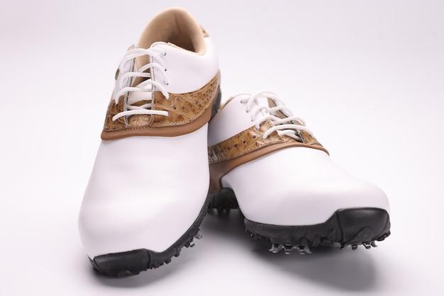 Closeup of beautiful white sport golf shoes