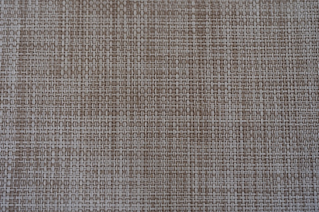 Closeup beige and white color weaving texture of food sheet, abstract background