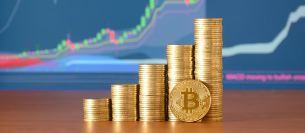Closeup of bitcoin digital currency and coin money stacks