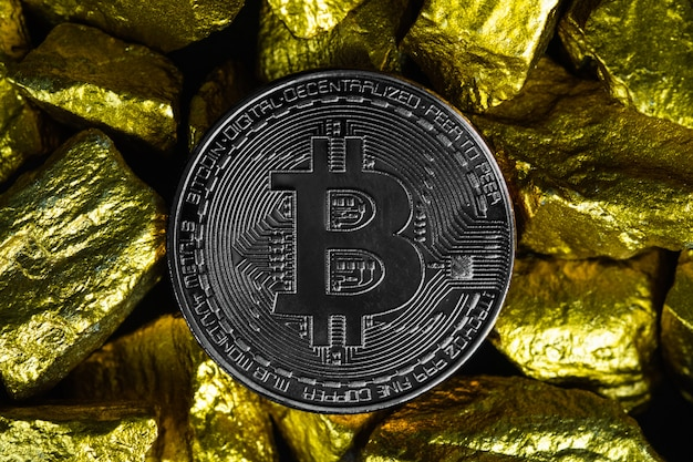 Closeup of bitcoin digital currency and gold nugget or gold ore