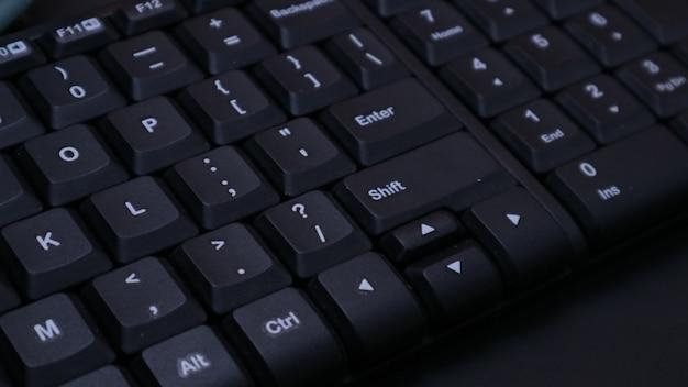 Closeup black keyboard on dark background