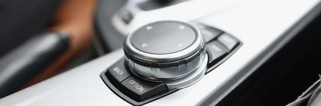 Closeup of black knob control in car