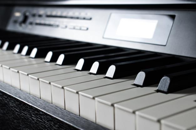 Closeup black piano keys.