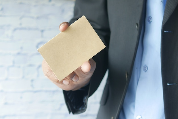 Closeup of blank business note card on mans hand