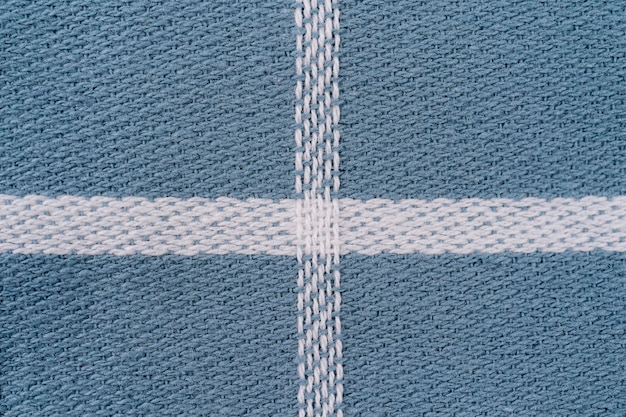 Closeup of a blue and white checkered napkin or tablecloth use for background. kitchen accessories