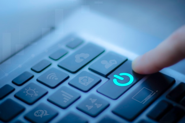 Closeup of blurred finger of business woman use computor laptop to switch off or shut down online
