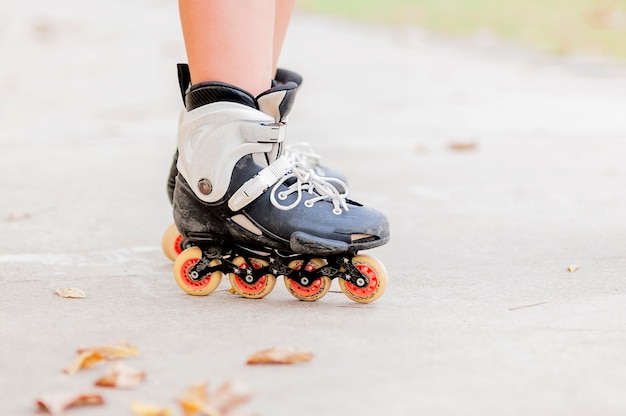 Closeup of boy is standing with roller blade, selective focused.