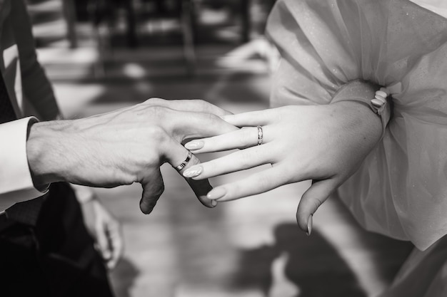 Closeup of the brides and grooms hands black and white photo of the bride and groom a place for text...