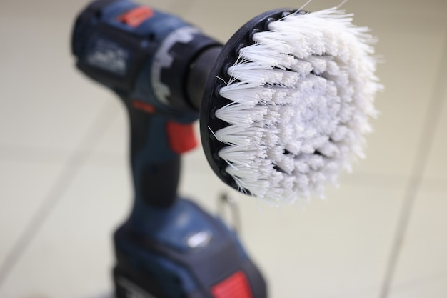 Closeup of brush on car polishing machine sale of tools for car maintenance and repair concept