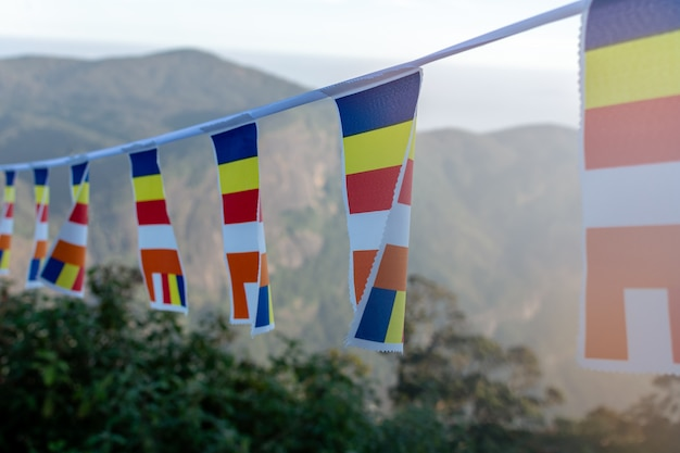 Closeup of buddhist flags near adams peak, sri lanka