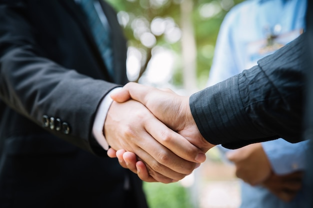 Closeup of a business handshake. business people shaking hands, finishing meeting.