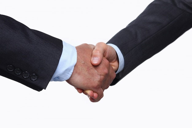 Closeup of a business handshake , isolated on white background