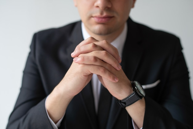 Closeup of business man with clasped hands