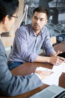 Closeup of business partners negotiating
