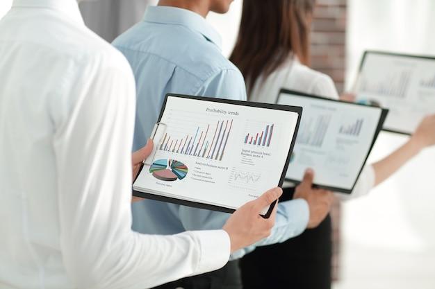 Closeup.business team keeps files of financial graphs